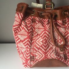 Lucky brand printed sling bag Printed fabric sling bag. Snap closure and multiple pockets inside. Also available in blue and black Lucky Brand Bags