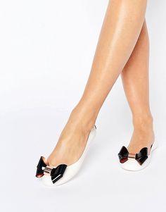 Image 1 ofTed Baker Cream/Black Faiyte Bow Jelly Shoes