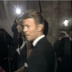 "queenlovett: "" faithlessandstateless: "" I wonder how many people fainted when he turned around? "" Bowie, David Bowie. """