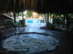 The hot tub and pool are secluded in a tropical forest. #KeyWest #KeyWestHotel #marriottcourtyardkeywest