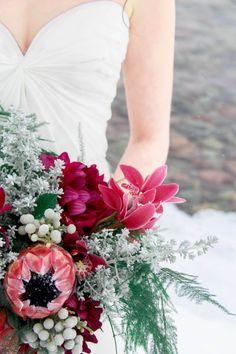 Red and green winter wedding bouquet: http://www.stylemepretty.com/montana-weddings/2014/03/17/winter-wedding-inspiration-in-lakeside-montana/ | Photography: Hope Kauffman - http://hopekauffman.wix.com/