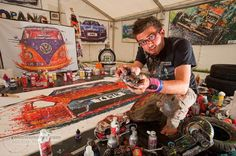 Ian Cook paints with radio controlled cars