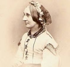 net head dress. I love the trim and dark collar. Makes me wonder if she is in second mourning, perhaps the dress is gray or lavendar?