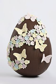 SPRING EASTER EGG IN CHOCOLATE WITH FLOWERS AND BUTTERFLIES
