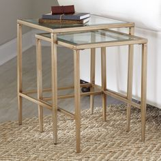 Nash Nesting Tables | A glamorous mix of clear tempered glass and gold-finished metal, the look of these tables is both airy and luxe.