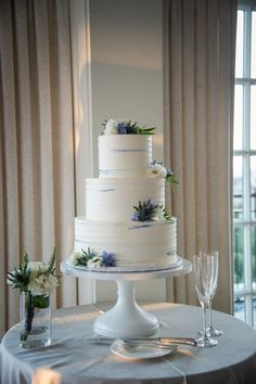 White buttercream wedding cake with blue accents