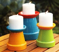 Candle Holders. so easy. a couple of terracotta pots painted with patio paint. great for summer tables