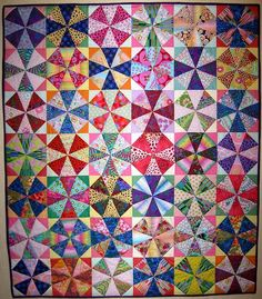 Kaleidoscope...when colors are placed carefully, overlapping circles result but its all straight line piecing