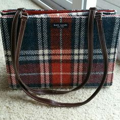 Kate Spade Purse Wool, with leather straps. Has 2 areas with ink spots on inside of lining. Bag has no outside stains. Used and loved. Bought at Nordstroms. Kate Spade  New York  Accessories