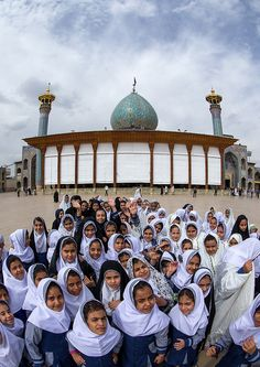 veiled muslim shiite schoolgirls in front of the shah-e-cheragh mausoleum, Fars Province, Shiraz, Iran | © Eric Lafforgue www.ericlafforgue.com