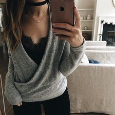 Wrap sweater with a lace cami underneath                                                                                                                                                                                 More