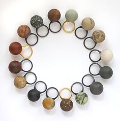 Warwick Freeman From North Cape to Bluff - a collection of rings made from materials collected by Freeman on a journey from the north to south tip of New Zealand