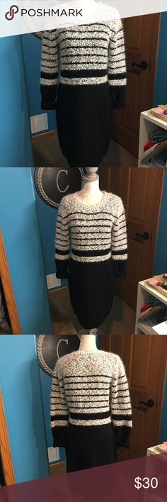 Calvin Klein Black and White Sweater Dress Calvin Klein Fuzzy Sweater Dress. Item has been previously worn , but it is in great condition! No signs of wear or tear! Perfect for the Winter time!  Check out the rest of my closet for other items you're interested in! Bundling 3+ items means you automatically get 15% off your entire purchase! Calvin Klein Dresses Long Sleeve
