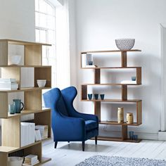 Balance shelving: Content by Conran - An open freestanding shelf unit creates lots of extra space for display. Balance tall shelving £599 and Duke armchair from £1,395 (contentbyconran.com)