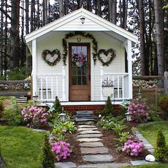 This 10'x16' post and beam prefab cottage can serve as a home office, guest quarters, workshop, playroom or hangout. The hearts and pink flowers could be swapped for more manly plants (gunnera or cordyline). | Tiny Homes