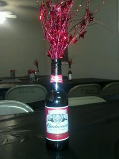 Simple Table decorations for a beer theme party. Empty bottle with a Balloon weight (cut off weight) to add flair!