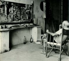 Artist Pablo Picasso with his Artwork