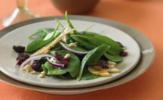 Spinach Salad with Bosc Pears, Cranberries, Red Onion, and Toasted Hazelnuts / Leigh Beisch