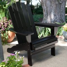 The Belham Living Shoreline Deluxe Adirondack Chair - Black is designed to encapsulate the essence of an unforgettable day at the beach - minus the.