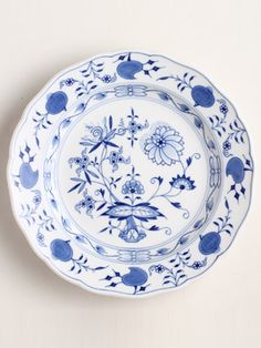 Blue and White Plate. Meissen's Blue Onion design, copied from a Chinese porcelain bowl decorated with peaches and pomegranates (fruits unknown in Germany at the time, hence the misnomer) has been in production since 1739.