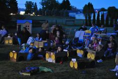 """How about a """"kiddy car"""" Drive-in Movie in your backyard?   Gather some boxes and let the kids build their ride! Yellow plates for head lights, red for tail lights and black for wheels and steering wheel."""