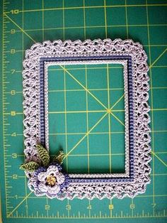 "Dizzy Designs ""exclusive"" crochet photo frames for wall or scrap-pages, handmade by Diane Zyla and sold as each was is made. Some with seed beeds, clay creations, and crochet flowers."
