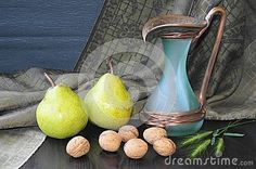 Pears, nuts, spice and jugful on the black background