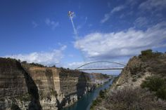 VISIT GREECE| Peter #Besenyei completes an amazing flight through the famous #Corinth #Canal in #Greece. The Hungarian pilot crosses the base of the 6.4km-long and 21.4m-wide landmark while performing impressive aerial manoeuvers and breathtaking tricks.