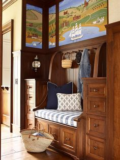 A custom mural by artist John Thom adds color and whimsy to this mudroom - Traditional Home®