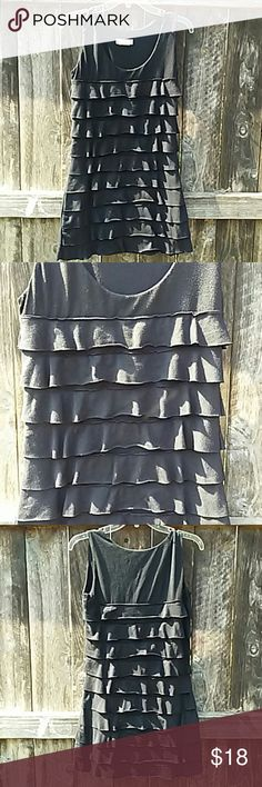 """Long Ruffled Tank Black ruffled tank top. Very cute. Easy to dress perfect for summer. Gently worn. 95%Rayon and 5% spandex size medium but can also fit a large. this top has stretch to it. Measures 25"""" from front to bottom and 30"""" from back of top to bottom Armpit to armpit is 17"""". Any questions please ask! Tops"""