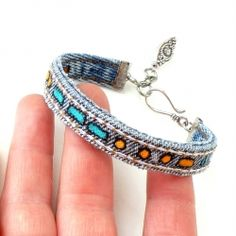 Use the inseam of an old pair of jeans to make these adorable personalized jean bracelets. Full tutorial includes the Morse code reference!