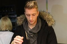 Like Mario Balotelli, Marco Reus is also fond of fur-trimmed hoods.