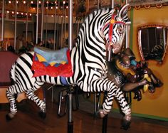 The Toledo Zoo African Carousel Zebra, Mandrill and Warthog © Mark Nance