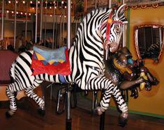 The Toledo Zoo African Carousel Zebra, Mandrill and Warthog © Mark Nance