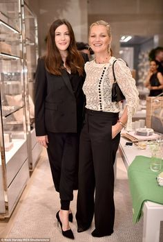 Friends reunited: Liv Tyler, 39, and Kate Moss, 42, looked thrilled to catch up at a cocktail reception to celebrate model Lucie de la Falaise's collaboration with Dior Maison at House of Dior, London, on 13 Sept 2016.
