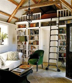 Such an adorable little space. I never said I needed a lot of room. Plus I have always wanted a library ladder like that!