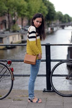 Nisi is wearing a semi-striped sweater outfit in Amsterdam - teetharejade.com
