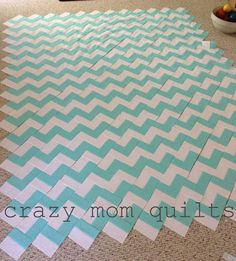 FINALLY! Instructions for a zig zag quilt using jellyrolls.  I'm dying to try this... I think it would go super fast.