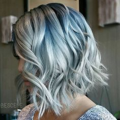 shaggy wavy silver bob with black roots