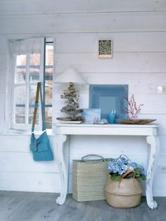 white washed table on beach for food, dessert, or candy bar