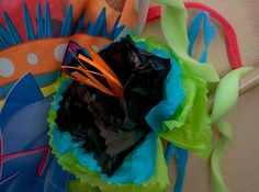 This is a fun tissue-paper flower at Weird Animals VBS. We had these tucked all over the church. An easy, inexpensive way to bring in bright colors and texture! Tissue Paper Crafts, Tissue Paper Flowers, Vbs Crafts, Crafts To Do, Catholic Kids, Vacation Bible School, Family Crafts, School Decorations, Jungle Theme