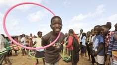 'Inspired by Sport'  Children play with hula hoops from specially designed sports kits in Chiputo, eastern Mozambique. © International Inspiration/2012/Rebecca Hearfield