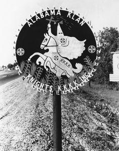 Continuing display of Ku Klux Klan signs on U.S. highways in violation of federal regulations.