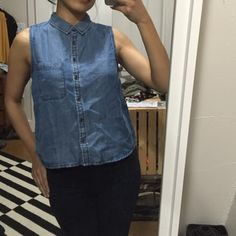 Sleeveless Denim Top. Short, but not cropped. Hits at waist. Slightly loose fit. Has a cool cut design at the back for fresh look and fun twist. Only worn a couple of times. No wear and tears. Practically brand new. Forever 21 Tops Button Down Shirts