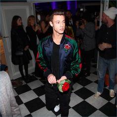 Cameron Dallas wears a Carolina Herrera bomber jacket at a party for 212 VIP.