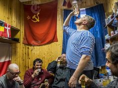 Russian and Chilean researchers drink homemade vodka at the Bellingshausen Station on King George Island in Antarctica, Nov. 28, 2015. Antarctica is a vast place, nearly twice the size of Australia, but it has no permanent population and sovereignty is a muddle, making criminal cases there difficult to handle.