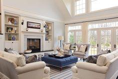 Garrison Hullinger Interior Design, photo Blackstone Edge Photography.   Wall color, hardware, fireplace surround
