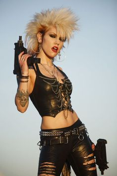 Photo about A young punk rocker woman with two automatic pistols. Image of beauty, model, automatic - 9070015 Chicas Punk Rock, Estilo Punk Rock, Post Apocalypse, Punk Rock Girls, Wasteland Warrior, Arte Punk, Post Apocalyptic Fashion, Dark Circus, Creation Couture