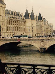 Castle Conciergerie (former royal palace) and Seine river, Paris.  The prison tower where Marie Antoinette spent her last days. Hundreds of prisoners during the French Revolution were taken from the Conciergerie to be executed on the guillotine at a number of locations around Paris.