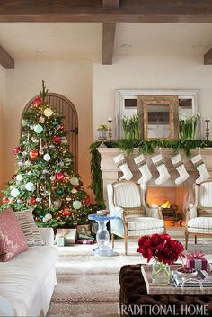 Custom-made stockings are hung by the chimney with care. Traditional Home ® / Photo: Emily Minton Redfield